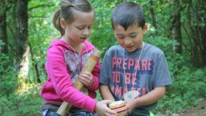 two-kids-sharing-at-camp